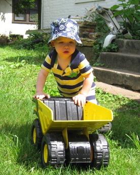 Calvin and Tonka truck in the backyard