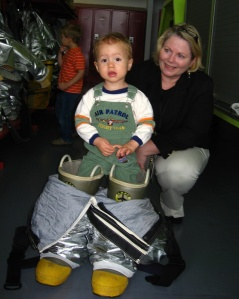 toddler gets taller with firefighter boots