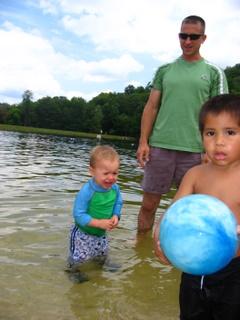 An older boy beats Calvin to the beach ball.  Calvin is not pleased.  (Mint Springs, VA)