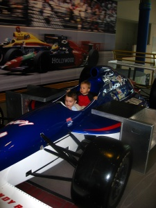 Calvin and Cousin J in an Indy 500 race car